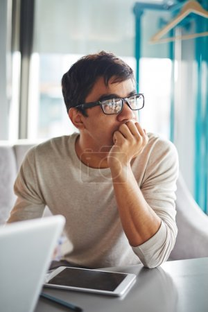 Pensive guy in eyeglasses