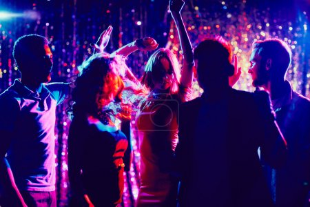 Photo for Group of young people dancing in the night club - Royalty Free Image