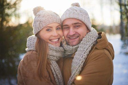 Joyful sweethearts in winter wear
