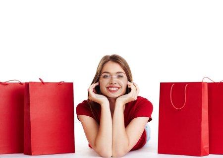 woman lying between shopping bags