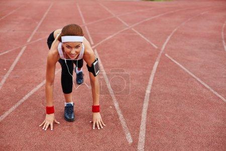 Sporty woman on racetrack
