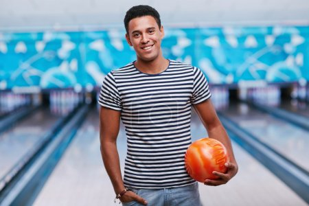 Young smiling man with ball