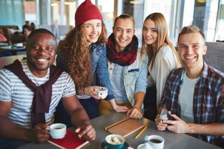 teenagers having coffee in cafe