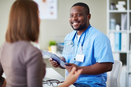 Happy doctor talking to his