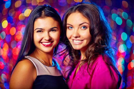 Photo for Portrait of two attractive women in evening dresses in club - Royalty Free Image