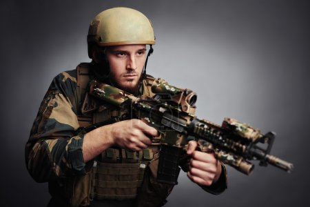soldier of special forces holding gun