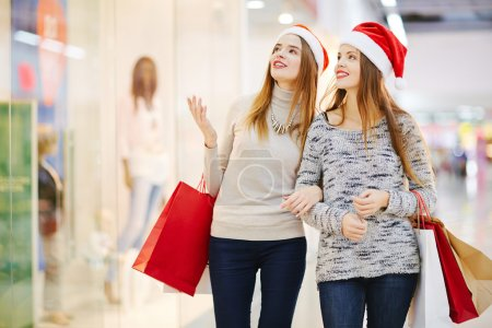 women walking in shopping mall