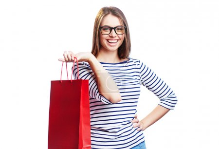 Photo for Happy woman with red shopping bag looking at camera isolated on white background - Royalty Free Image