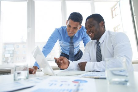 Photo for Businessmen working in team and using laptop - Royalty Free Image