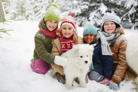 Kids with fluffy dog