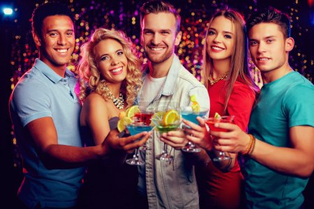 Photo for Group of friends holding martini glasses with cocktails - Royalty Free Image