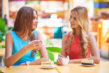 girls having cheesecakes with coffee