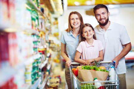 family buying food in supermarket