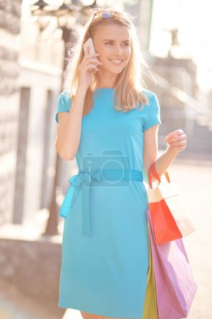 Young shopper calling