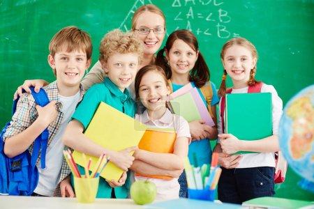 primary schoolchildren and teacher