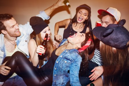 Photo for Group of friends communicating at home party - Royalty Free Image