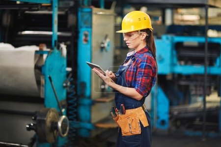 female engineer with digital tablet