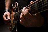 men playing on guitar
