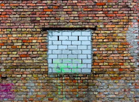 Bricked up window on a old brick wall
