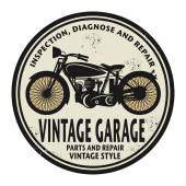 Grunge rubber stamp with the words Vintage Garage