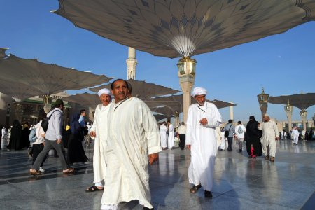 Muslims dressed in traditional clothes in Nabawi Mosque, Medina,
