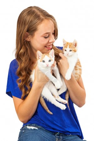 Young girl Holding Two Kittens