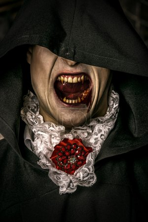 Photo for Bloodthirsty vampire grins. Halloween. - Royalty Free Image