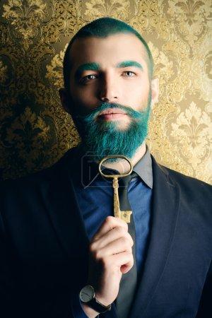 Photo pour Vintage portrait of a handsome man with blue beard. - image libre de droit