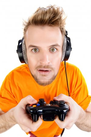 Photo for Crazy gamer with controller and headphones. Isolated over white. - Royalty Free Image