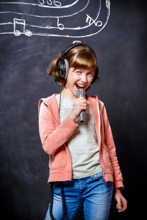 girl singing to microphone