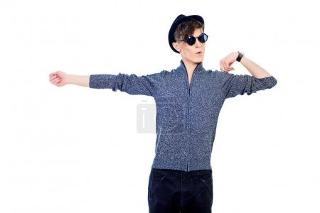 emotional guy. Hipster young man wearing hat and sunglasses.