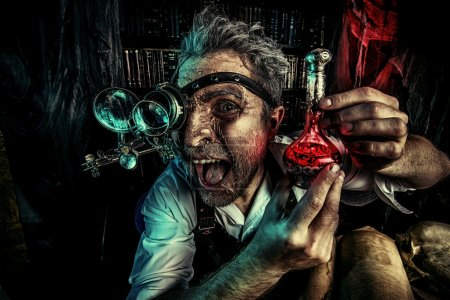 Photo for Portrait of a crazy medieval scientist working in his laboratory. Alchemist. Halloween. - Royalty Free Image