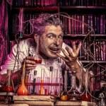 Crazy old man medieval scientist working in his la...