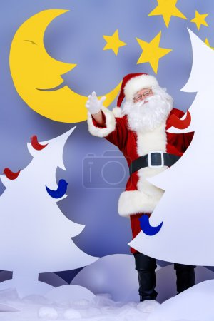 Photo for Santa Claus in a cartoon fairy snowy forest. Full length portrait. - Royalty Free Image