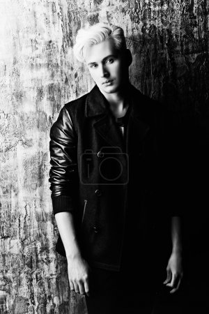 Photo for Portrait of a beautiful male model with blond hair wearing black jacket. Urban style. Fashion. - Royalty Free Image