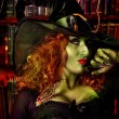 Close-up portrait of a fairy wicked witch in the w...