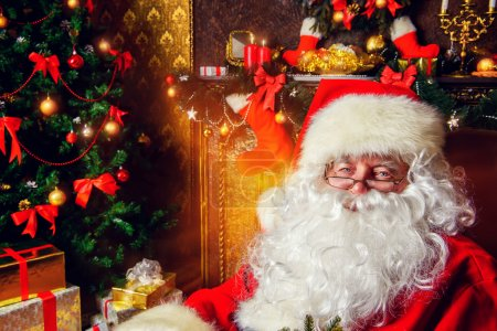 Photo for Santa Claus at home with gifts. Christmas. Decoration. - Royalty Free Image