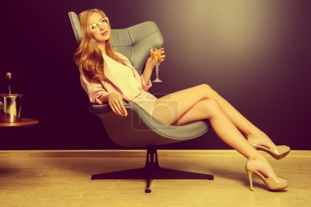 Photo for Portrait of a beautiful fashionable model sitting in a chair in Art Nouveau style. Interior, furniture. - Royalty Free Image