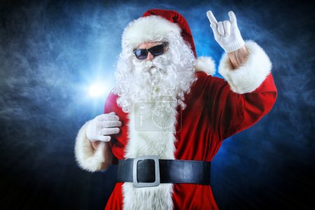 Photo for Modern Santa Claus in sunglasses over dark background. Christmas. - Royalty Free Image