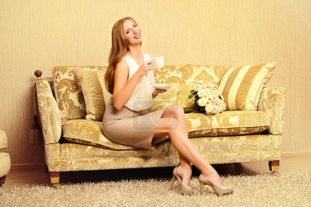 Photo for Charming young woman in a room with expensive classic interior. Interior. Furniture. - Royalty Free Image