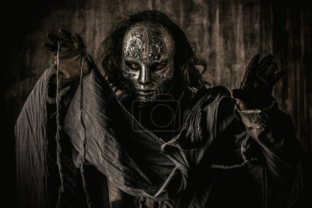 Photo for Portrait of a mysterious man in iron mask. Steampunk. Fantasy. Halloween. - Royalty Free Image