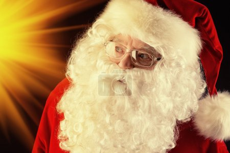 Photo for Close-up portrait of Santa Claus over black background. Christmas time. - Royalty Free Image