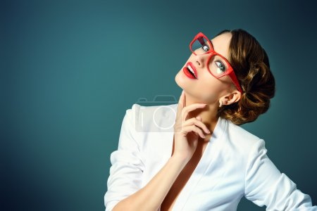 Photo for Close-up portrait of a gorgeous young woman wearing glasses. Beauty, fashion. Make-up. Optics, eyewear. - Royalty Free Image