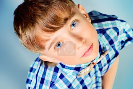 Photo for Close-up portrait of a smiling boy at studio. - Royalty Free Image