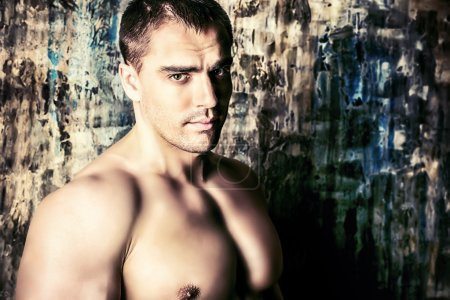 Photo for Portrait of a handsome muscular man over grunge background. - Royalty Free Image