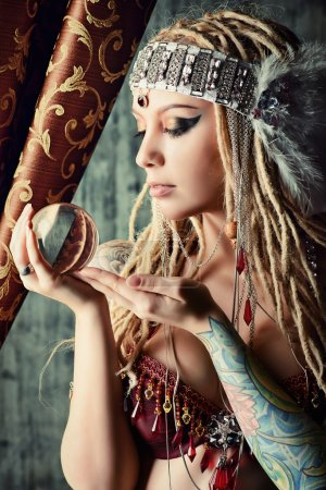 Photo for Magnificent fortune teller holding crystal ball. Divination. Magic. Halloween. - Royalty Free Image