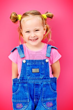 Photo for Portrait of a cute little girl over bright pink background. Happy childhood. - Royalty Free Image