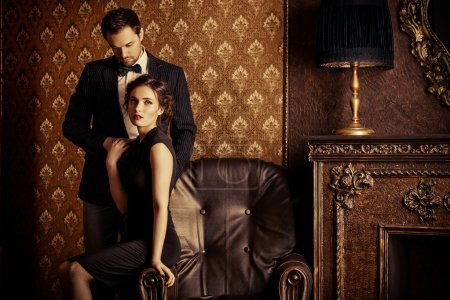 Photo for Beautiful man and woman in elegant evening clothes in classic vintage apartments. Glamour, fashion. Love concept. - Royalty Free Image