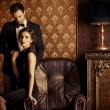 Beautiful man and woman in elegant evening clothes...