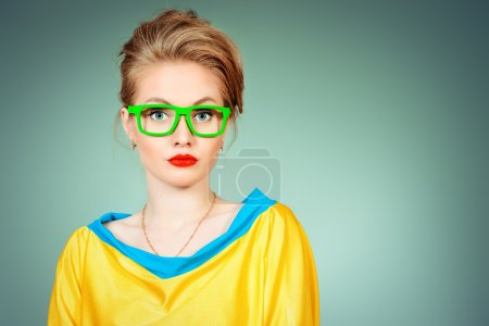 Photo for Close-up portrait of a pretty young womanl posing in vivid colourful clothes and glasses. Bright fashion. Optics, eyewear. Studio shot. - Royalty Free Image